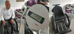 Mark and the wheelchair on a weighing scales
